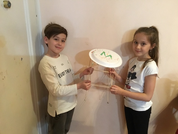 two child display their project