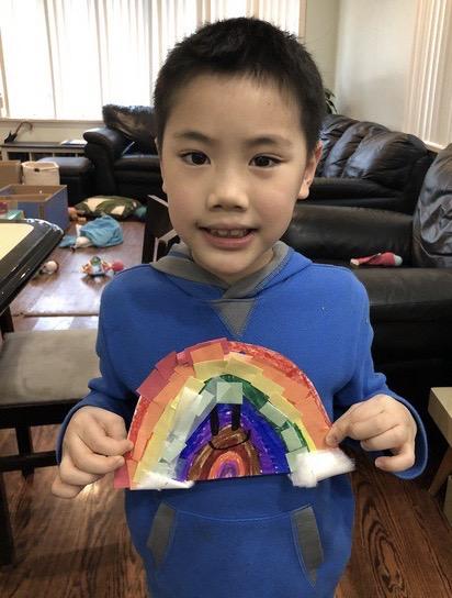 child holds a rainbow