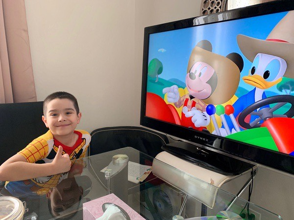 boy watching Mickey Mouse on TV
