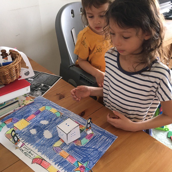 children play the board game they created