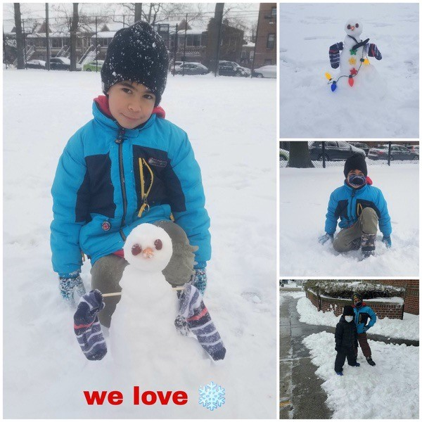 boy with his snowman and playing in the snow