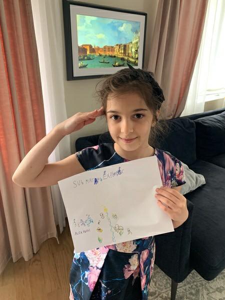child salutes her work