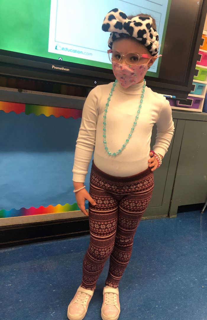 Kindergarten Student showing her 100th day of school spirit