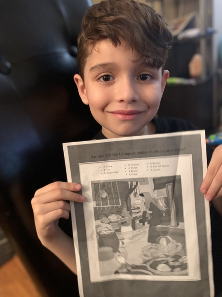 boy hold printed picture