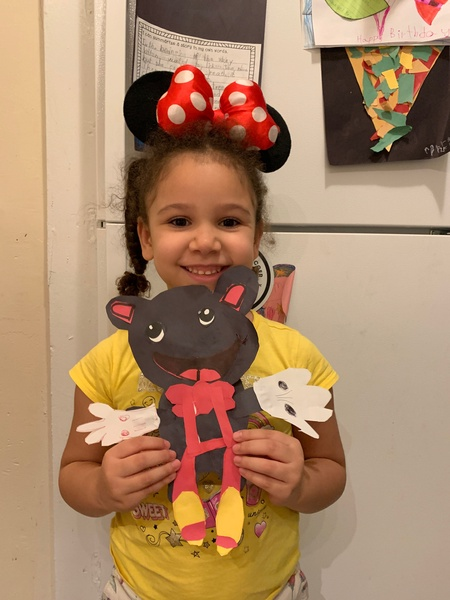girl smiling with mouse