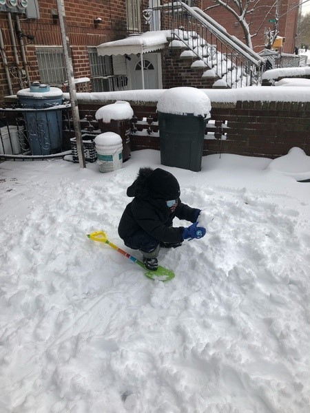 a child playing in the snow in the cold weather