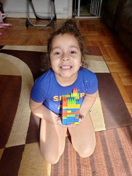 Child shows off Lego creation