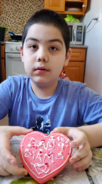 child who decorated his cookie