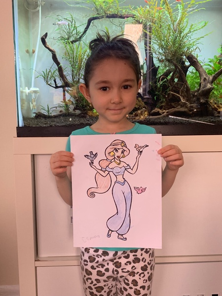 girl holds colored Jasmin in front of fishtanks