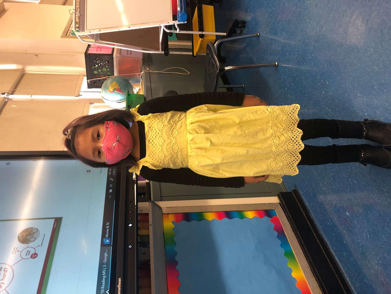 girl has pink mask and yellow shirt