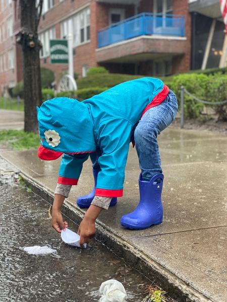 Child explores in the rain