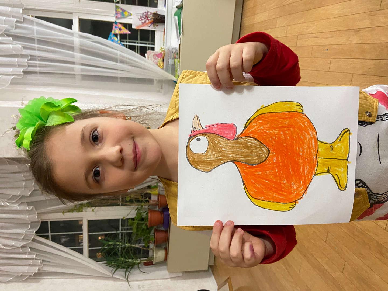 girl holding orange and yellow