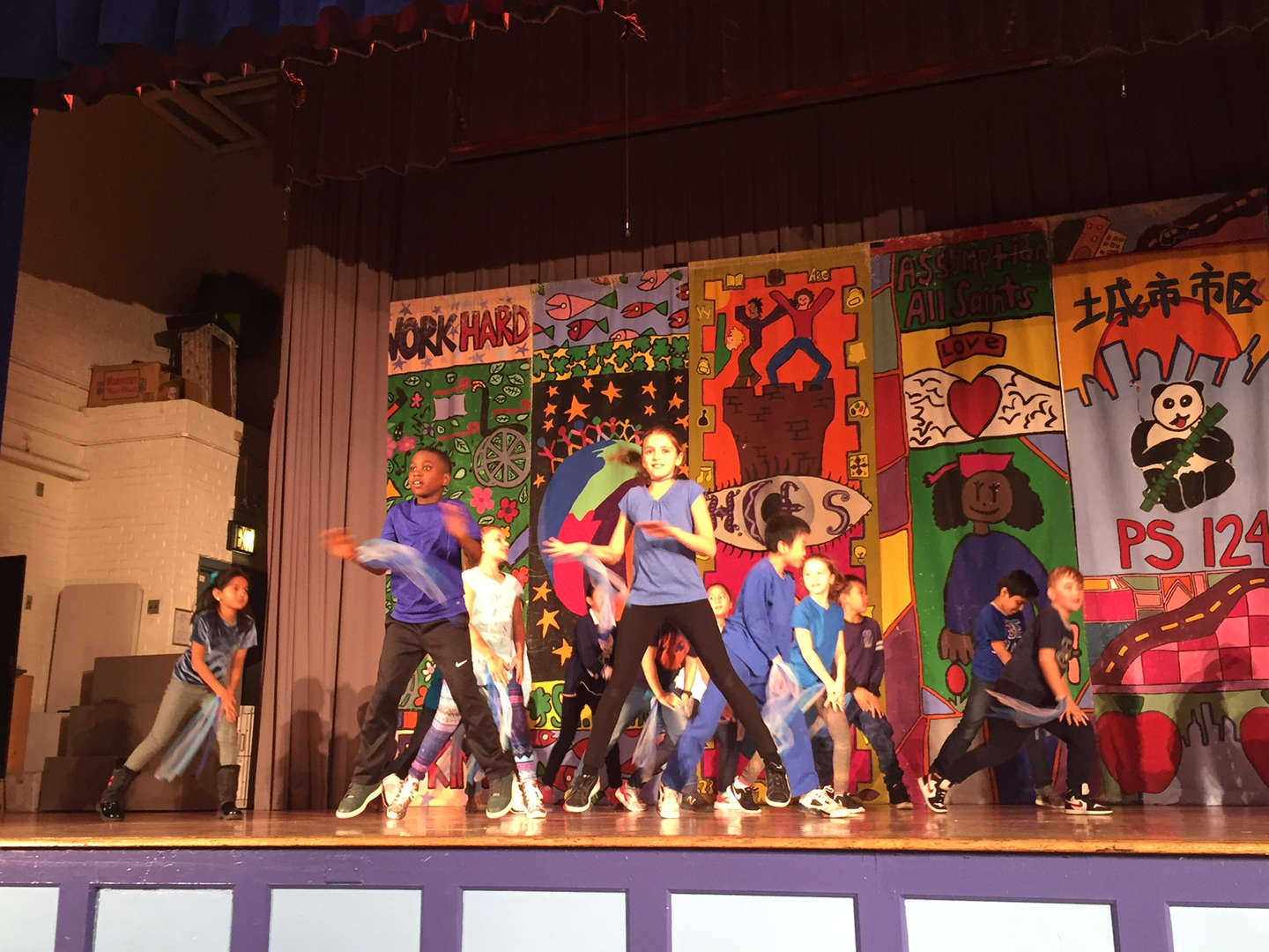 Students perform onstage at a dance performance!