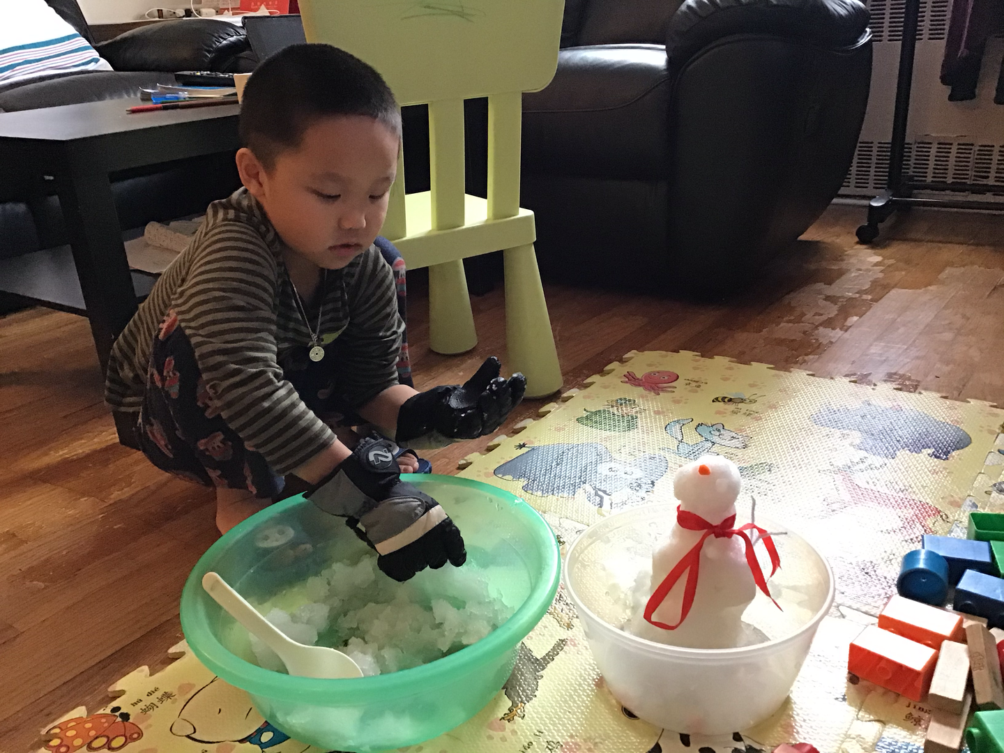a boy playing with snow in the house