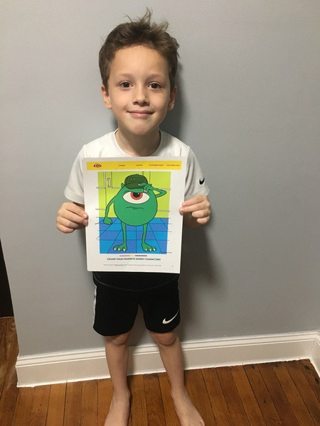 boy holds mike drawing