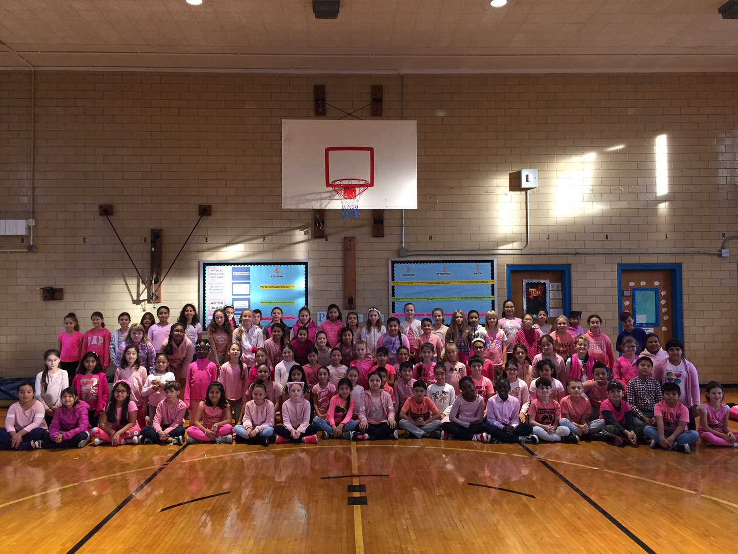 Students wear pink for breast cancer awareness.