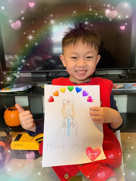 child has a rainbow made of hearts