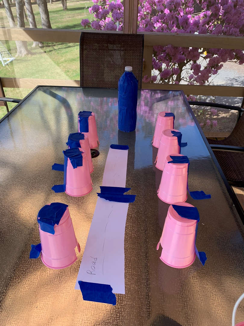 pink cups line the long table