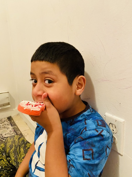 boy eats his decorated cookie