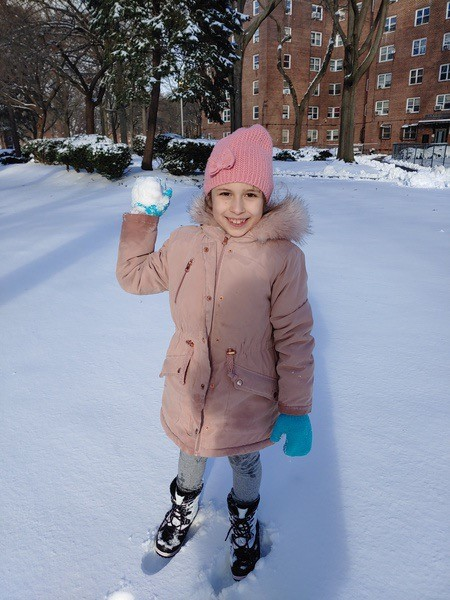 girl getting ready to throw a snowball