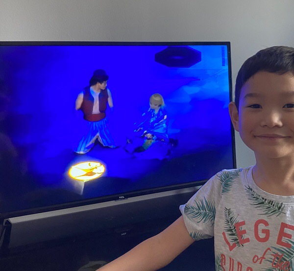 Disney play on television behinds boy