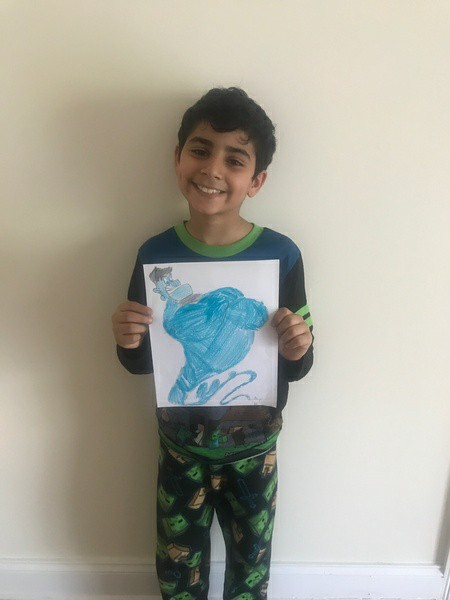 boy holds the genie her drew