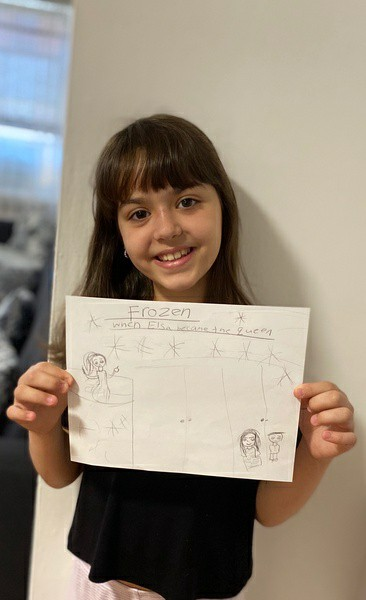 girl smiles with her work
