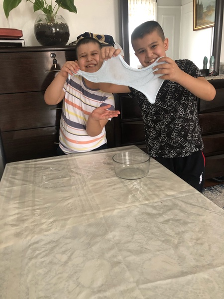 two children work together on the project