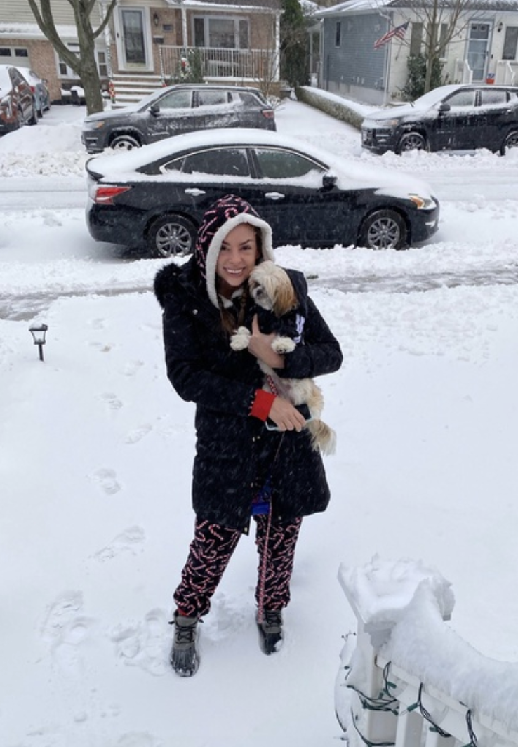 a teacher with her dog in the snow