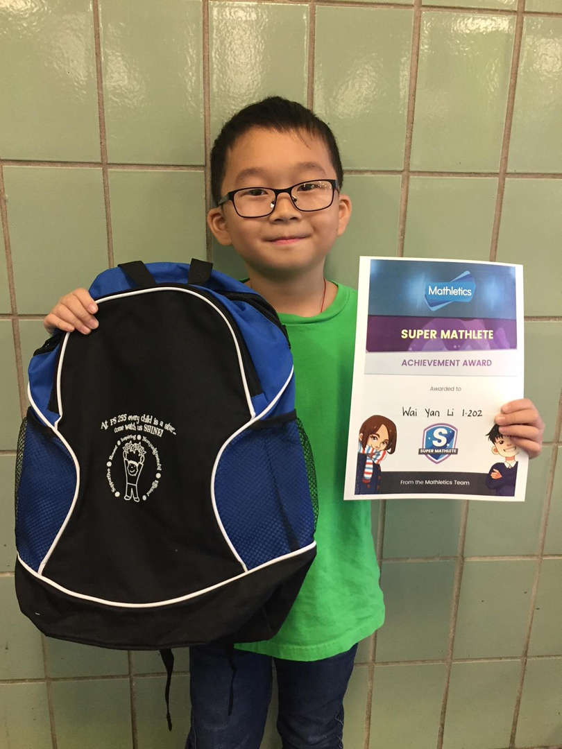 Student wins a backpack and certificate.