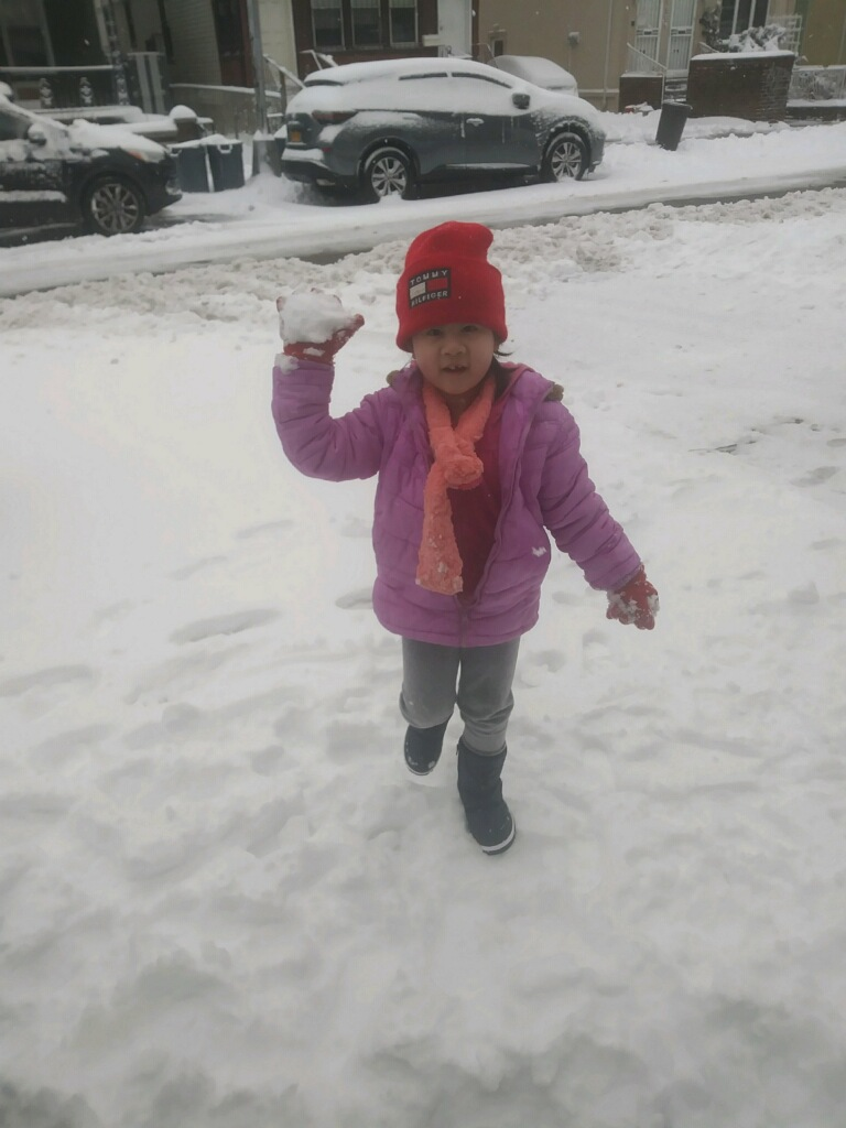 a child getting ready to throw a snowball