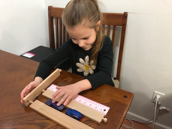 the child uses wood to build