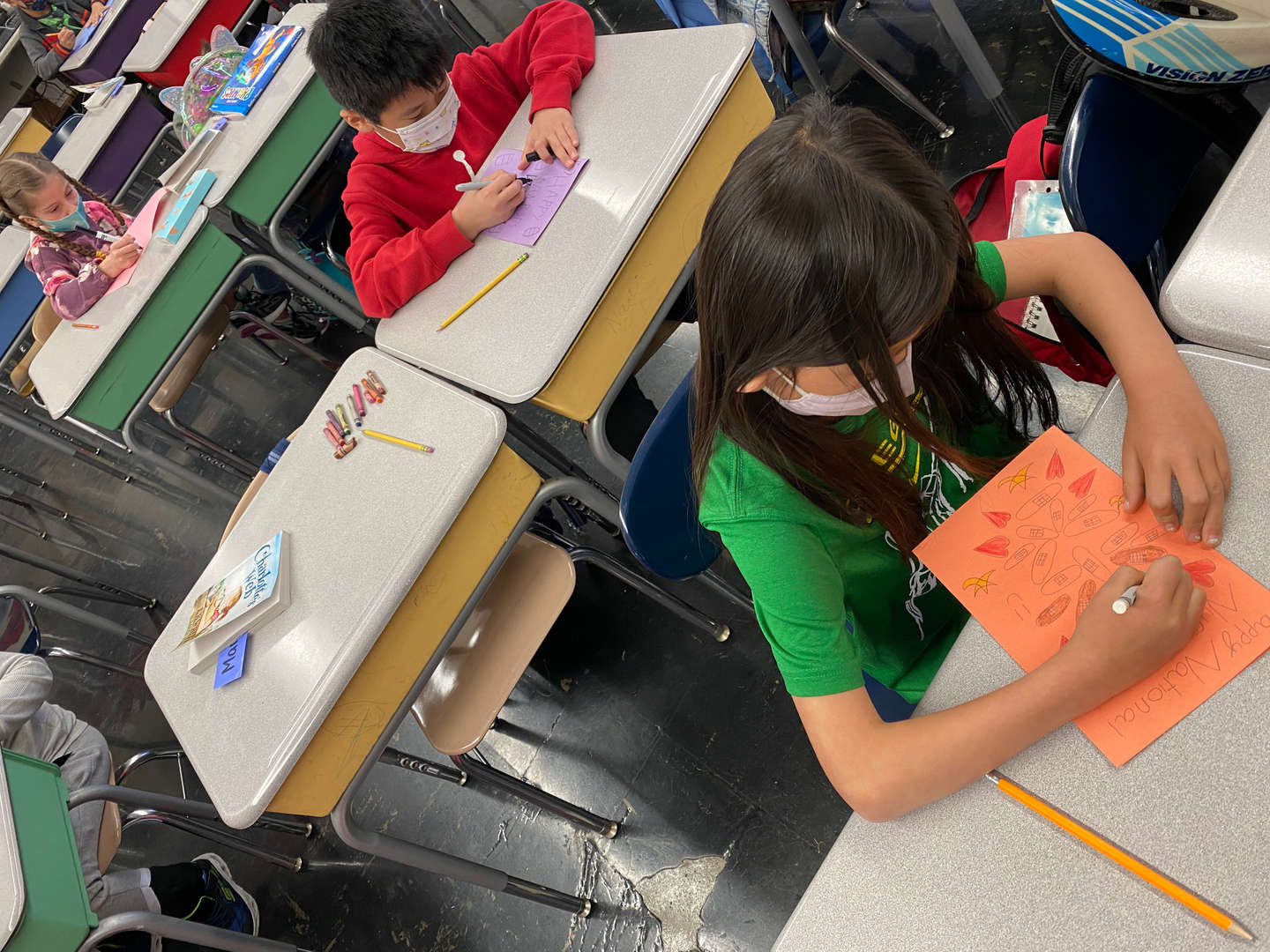 a student drawing an orange thank you card