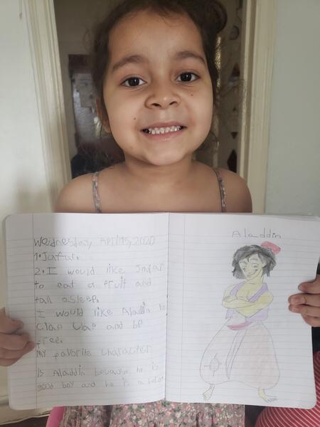 girl smiles sharing her work