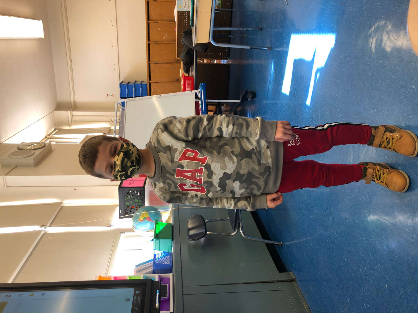student wearing our school colors