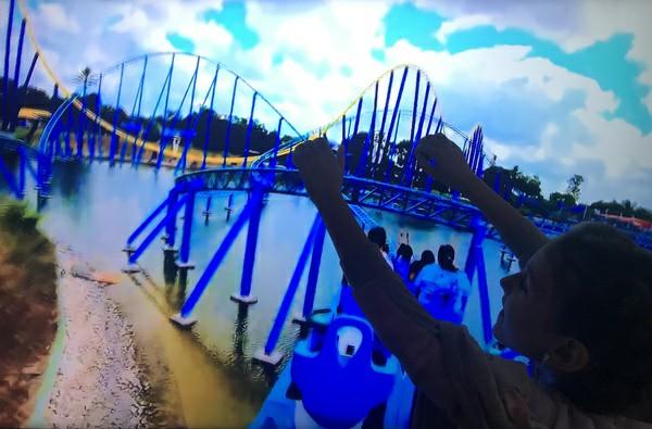 child on roller coaster