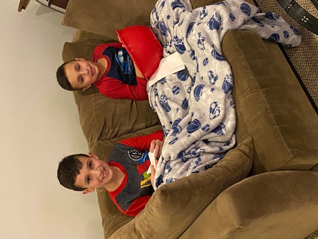 two brothers on a couch watching a movie