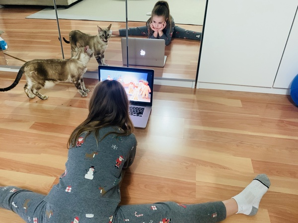 child works on the computer in front of the mirrors
