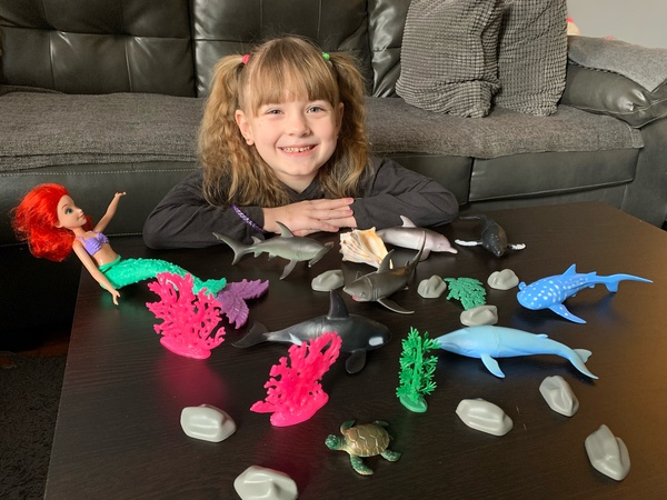 girl smiles with her toys