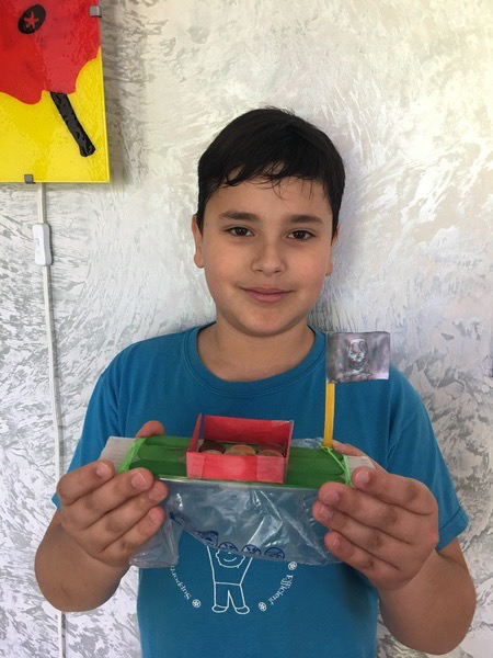 the child made a green and red boat