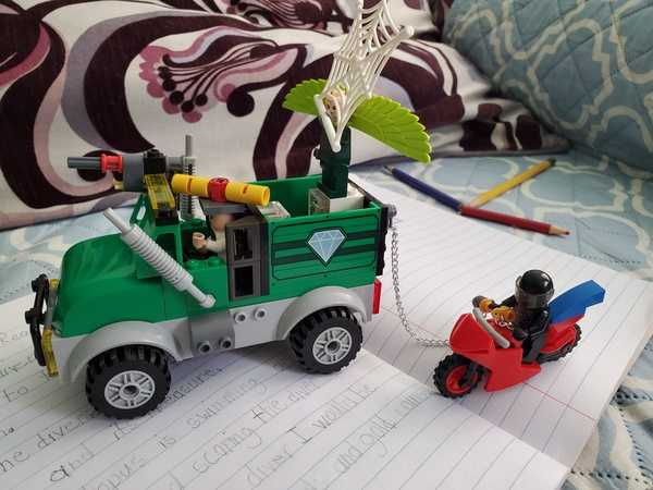 Child built a truck and bike using Legos