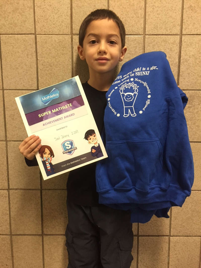 Another hardworking winner holding a sweatshirt and certificate.