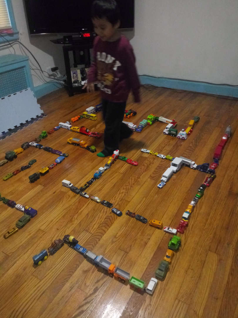 child made a large maze on the wooden floor