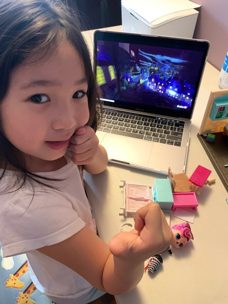 little girl watching play