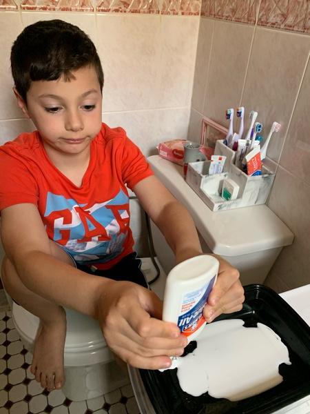 the boy glues his artwork
