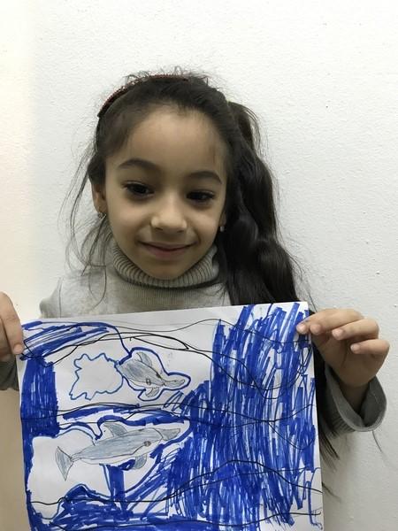 Girls shows aquarium drawing
