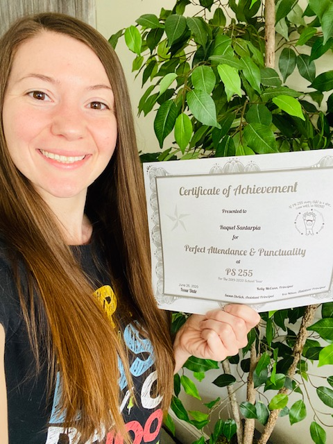 Mrs. Santarpia holds up her certificate