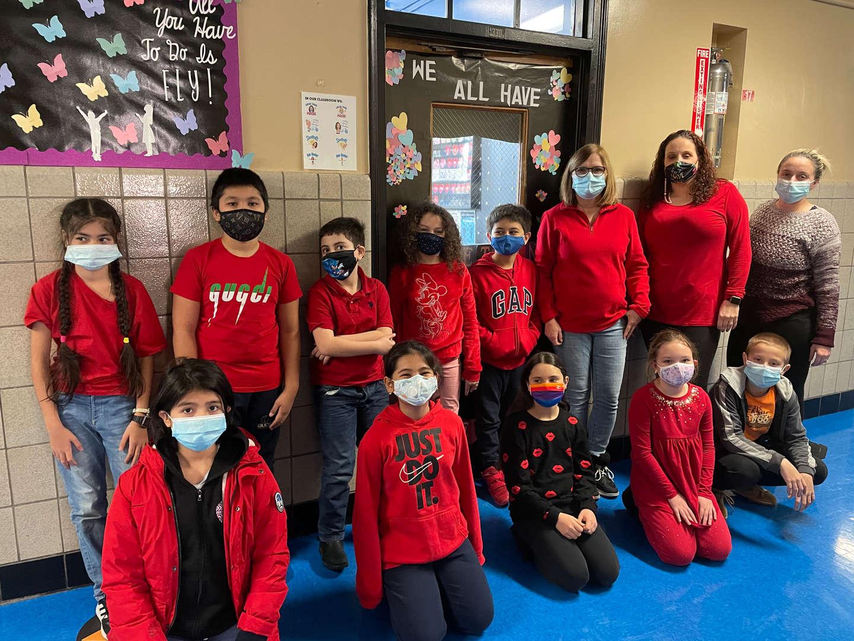 4th grade class wears red