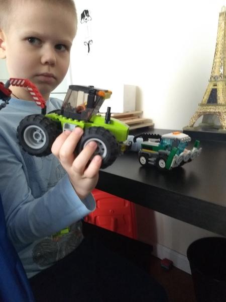 boy shows his lego truck