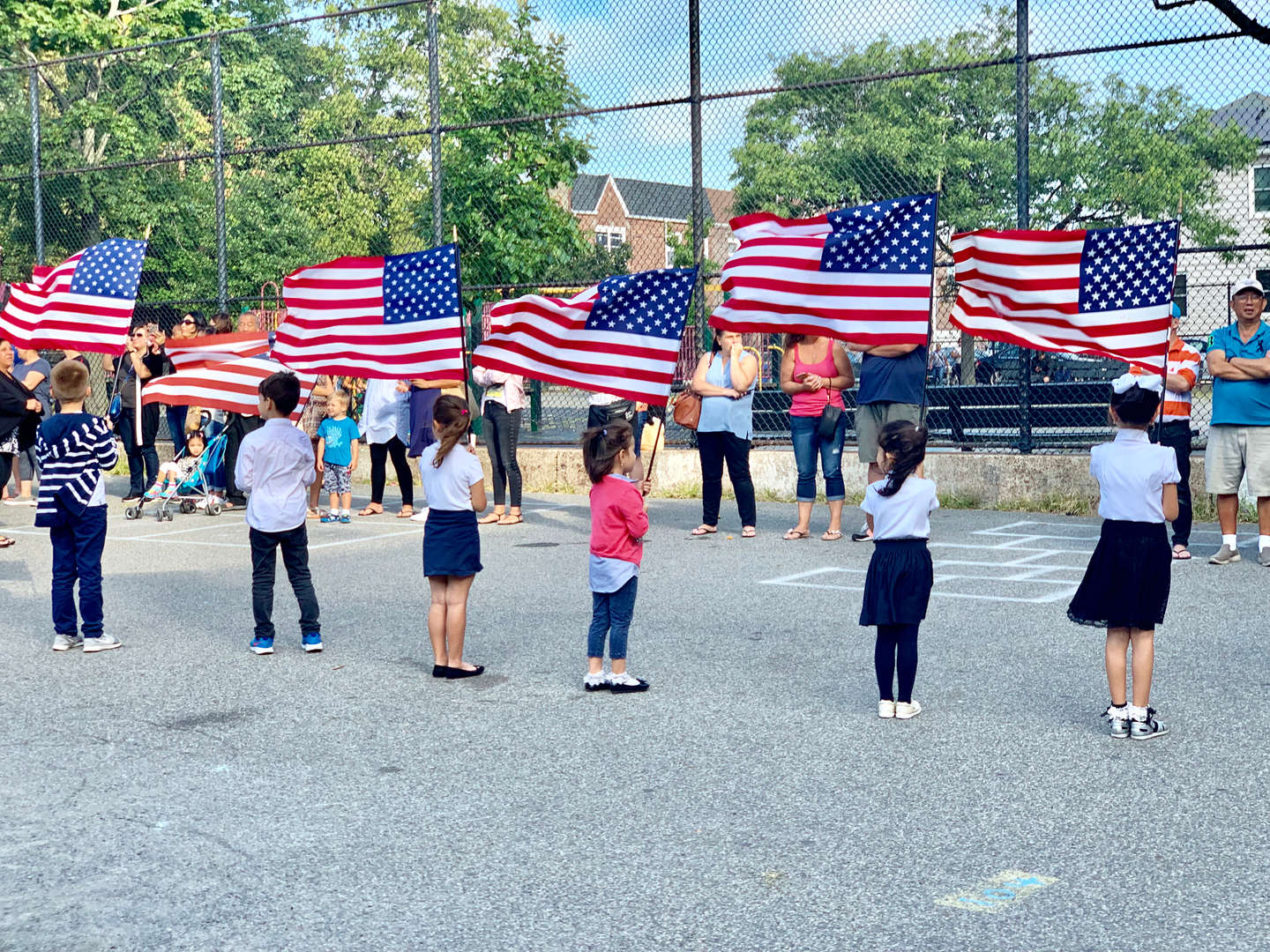 Students hold the American Flag to remember those lost at the 9/11 Memorial assembly.
